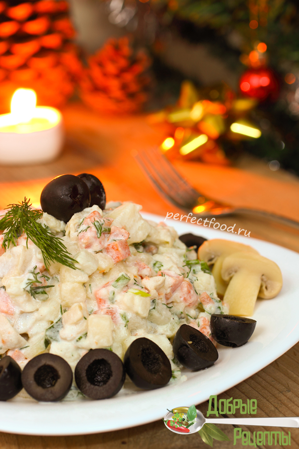 Traditional Russian salad on New Year night - vegetarian version with mushrooms